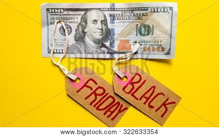 Black Friday Background, Friday Black Text With Money On A Yellow Background, Copy Space For Text. B