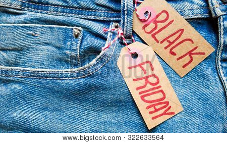 Stylish Jeans With A Black Friday Flag. Black Friday And Cyber Monday Sale Discount Concept Tag With