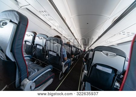 Airplane Cabin Seats With Passengers. Economy Class Of New Cheapest Low-cost Airlines. Travel Trip T