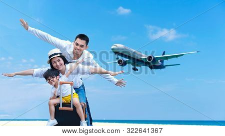 Asian Happy Family Have Fun On The Beach Watching The Landing Planes. Traveling On An Airplane For L