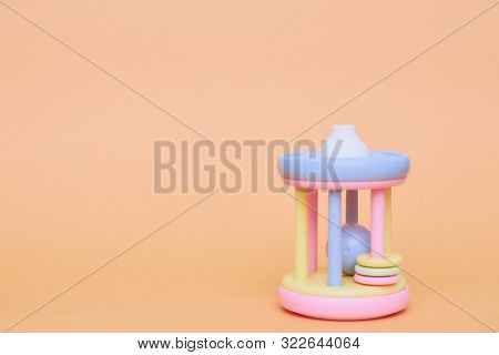 Childrens Colorful Pipe Toy On A Peach Background. Childrens Toy Insulator. Copy Space. Developing C