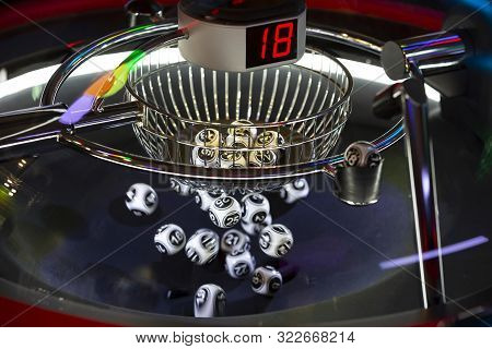 Black And White Lottery Balls In A Rotating Bingo Machine. Lottery Balls In A Sphere In Motion. Gamb