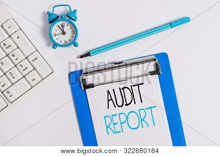 Conceptual hand writing showing Audit Report. Business photo showcasing An appraisal of complete financial status of a business Assets Flat lay above table with clock pc keyboard and note paper. poster