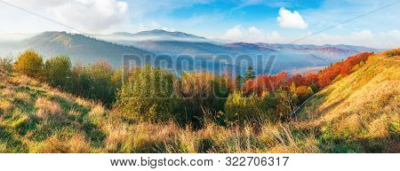 Great Panoramic Of Morning Landscape In Mountains. Light Passes Through Rising Fog In The Distant Va