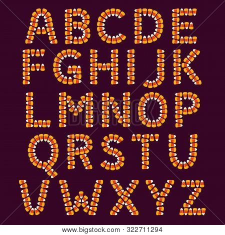 Halloween Alphabet Made Of Small Candy Corns On Dark Background. Holiday Trick Or Treat Concept Font
