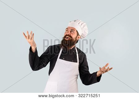 Chef Ready To Cooking New Dish. Bearded Man Chef In Uniform. Bearded Man In Kitchen Apron. Male Cook