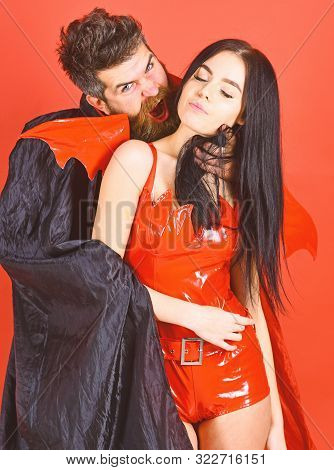 Vampire Bites Female Neck. Couple In Love Play Role Game. Vampires Victim Concept. Man And Woman Dre