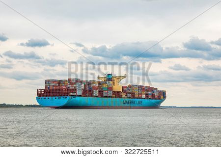 Stade, Germany - September 11, 2019: Container shiop EVELYN MAERSK on Elbe river heading to Hamburg