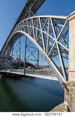 Porto, Portugal - 12 August 2019: Double Decker Steel Arch Bridge Across River Douro