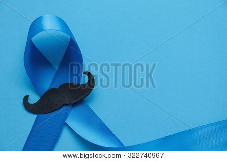Light Blue Ribbon With Mustache On Blue Background , Prostate Cancer Awareness, Men Health Awareness