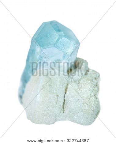 Blue Mineral Beryl Known As Aquamarine Gemstone, In An White Albite Matrix Isolated On A White Backg
