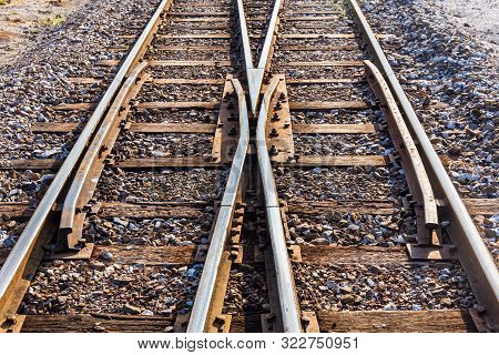Close Up Of Train Or Railroad Tracks With Cement Backing In The Countryside Thailand