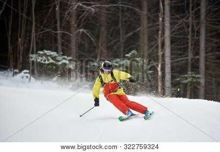 Young Skier Performing Skiing Trick. Ski Training During Snowfall. Carving Skiing Technique. Tall Tr