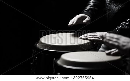 The Musician Plays The Bongo. Close Up Of Musician Hand Playing Bongos Drums. Afro-cuba, Rum, Drumme