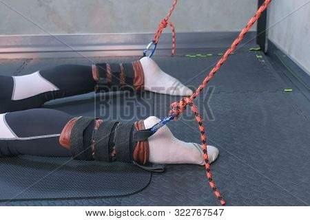 Instructor Fasten Ropes Fixators Sportsman Legs Prepare For Myofascial Stretching In Trainer Equipme
