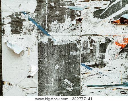 Old grunge ripped torn vintage posters creased crumpled paper surface texture background