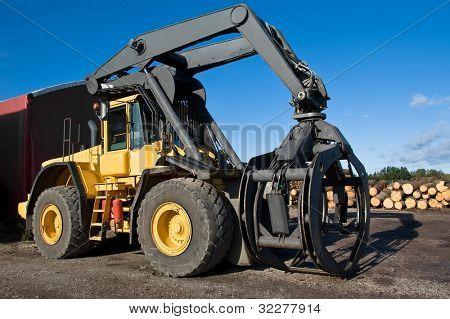 Big yellow grapple loader a summer day