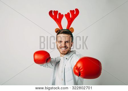A Guy In Boxing Gloves Is Waiting For Hot Packages. Man Is Determined To Break Prices. Knocks Out Di