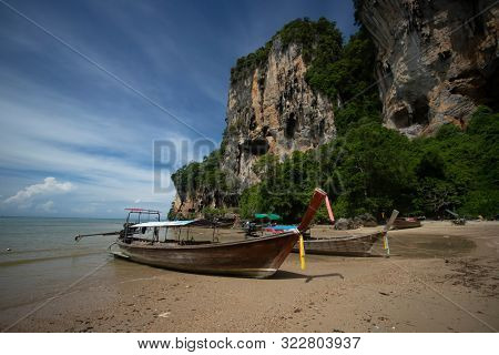 Thai traditional wooden longtail boat and beautiful sand beach at Tonsai beach in Krabi province. Ao Nang, Thailand.