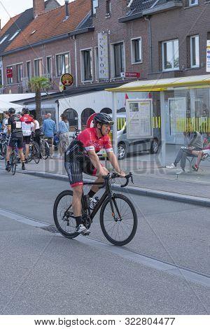 Sint Gillis Waas, Belgium, 2 September 2019, Man With Helmet And Black Bike Is Warming Up To Begin T