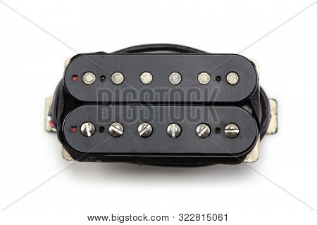 Electric guitar humbucker type magnetic pickup (double coil ) isolated on white background. Screw pole piece type. Black bobbin.