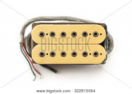 Vintage electric guitar humbucker type magnetic pickup (double coil ) isolated on white background. Creme bobbin.