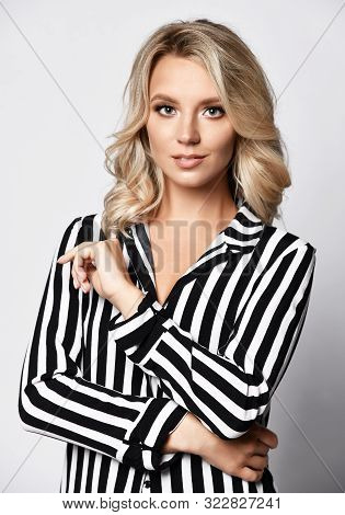Young Elegant Business Blonde Woman In Formal Wear Black And White Stripes Blouse Looking In Camera