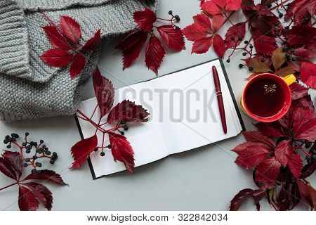 Cup Of Tea With Red Leaves Of Girlish (wild) Grape Or Parthenocissus, Plaid, Note Pad, Smartphone An
