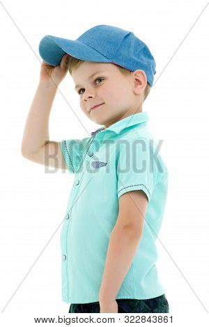 Cute Little Boy In A Cap. The Concept Of A Happy Childhood. Isolated On White Background.