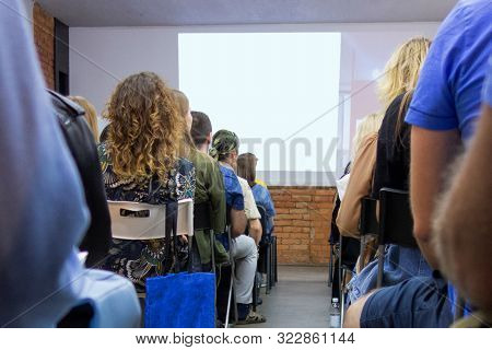 People In Auditory During Presentation Or Seminar. Teenagers Or Young Men And Women At University Le