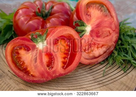 Tomatoes Prepared For A Traditional Greek And Turkish Salad With Olive Oil And Thyme On A Wooden Pla