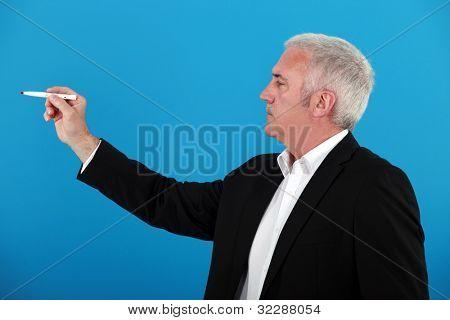 Businessman using a marker pen