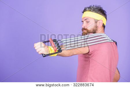 Athlete Sport Instructor. Lets Stretch Arms. Athlete Stretching With Expander. Sportsman Training St