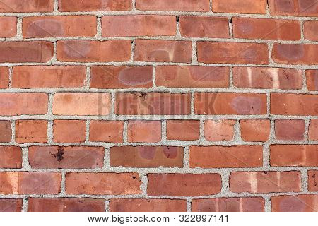 Red And Brown Bricks In A Heavy, Thick Wall Of Building, Signs Of Repair And Craftsmanship Seen Thro