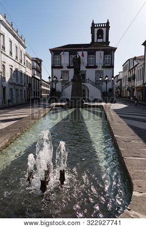 Ponta Delgada, São Miguel Island, Azores - August 31 2019: Closeup Of The Fountain And Reflecting Po