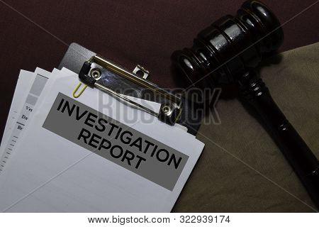 Investigation Report Document Form And Black Judges Gavel On Office Desk. Law Concept