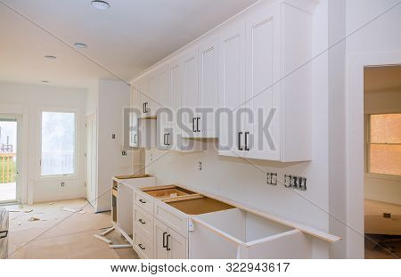 Custom Kitchen Cabinets In Various Stages Of Installation Base For Kitchen Cabinets