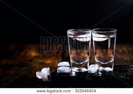 Cold Cocktail With Tonic, Vodka And Ice On The Wooden Background. World Vodka Or Brandy Day