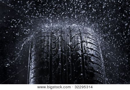 Car tire in rain.