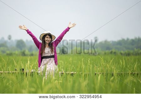 Let It Go,freedom Hand And Release Concept.lifestyle Of Young Girl Spread Hand  With Rice Field Back