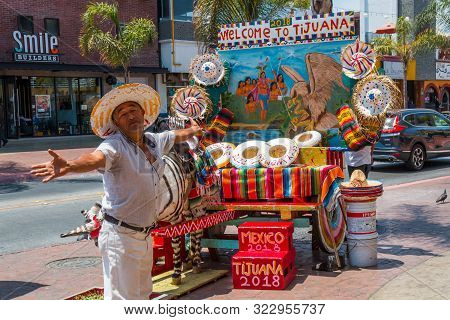 Tijuana, Baja California/mexico - June 20, 2018:  A Street Vendor Stands With Welcoming Arms In Fron