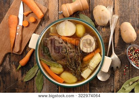 beef stew with broth and vegetable, pot au feu