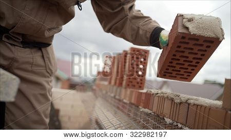 Construction Equipment For Brick Building Work Trowel. The Construction Of A Brick House. Worker Bui