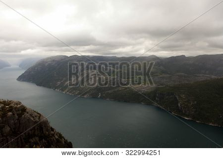 View From The Cliff Preikestolen In Fjord Lysefjord - Norway - Nature And Travel Background. Vacatio