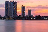 Modern buildings condominium at Chao Phraya River Bangkok Thailand at sunrise. poster