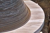 Joinery. Creative round shape coffee table made of mdf and natural wood poster