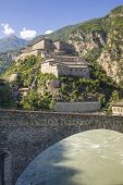 Bard (Aosta Italy) - The ancient fortress and bridge over the Dora river poster
