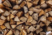 Woodpile with firewood. Close-up. Space for text. poster