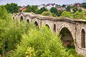 Old ottoman Terzijski Bridge over river Erenik near village Bistrazin in Kosovo poster