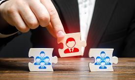 A Businessman Appoints A Leader To The Head Of The Team. Creation Of An Effective Teams Of Specialis